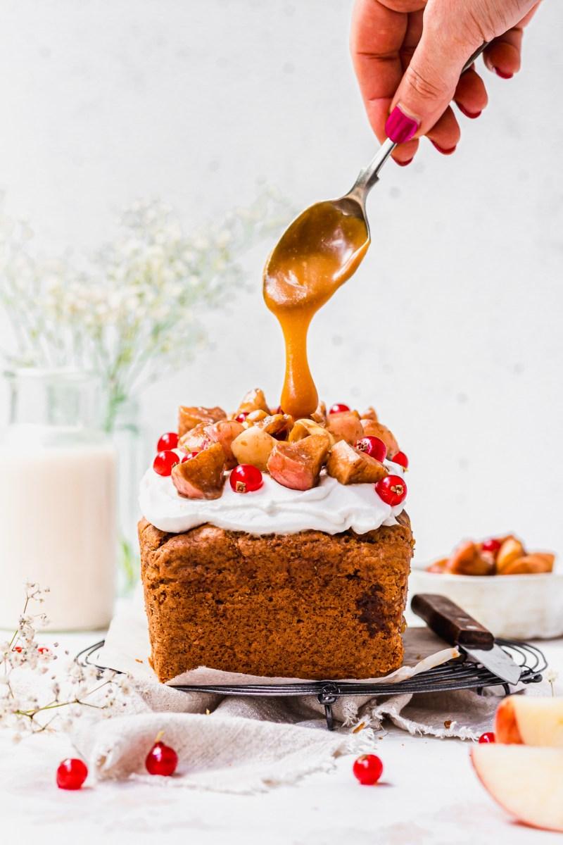 Caramel drizzling over a Caramel Apple Loaf Cake
