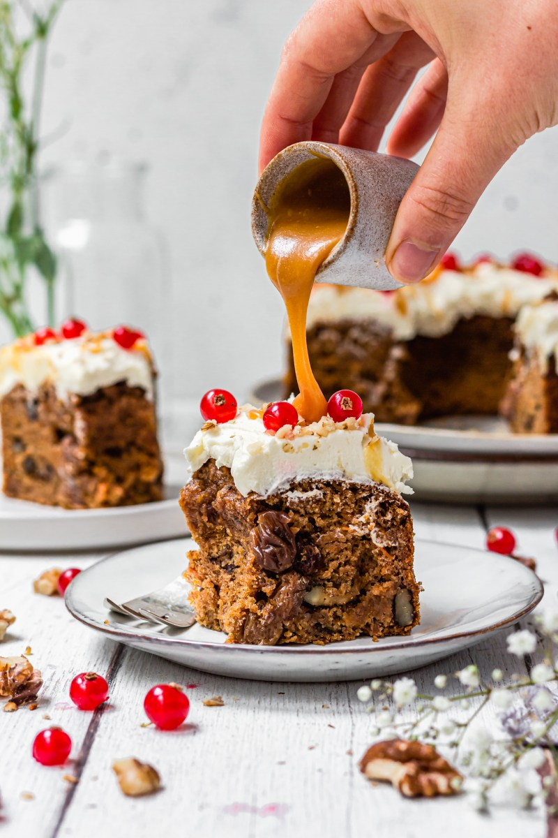 Pouring caramel over a slice of Carrot and Raisin Bundt Cake