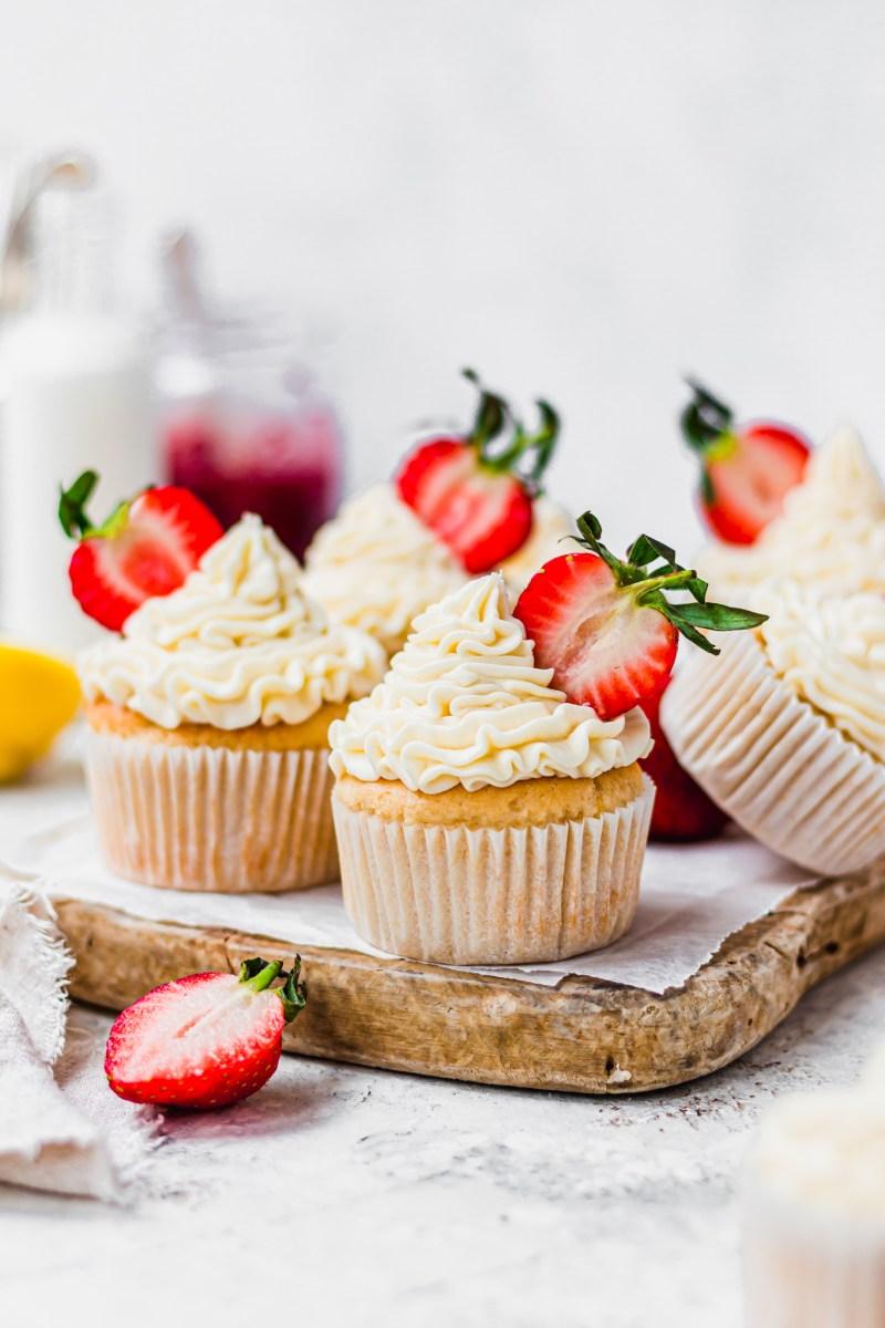 Vegan Lemon Strawberry Cupcakes on a wooden board