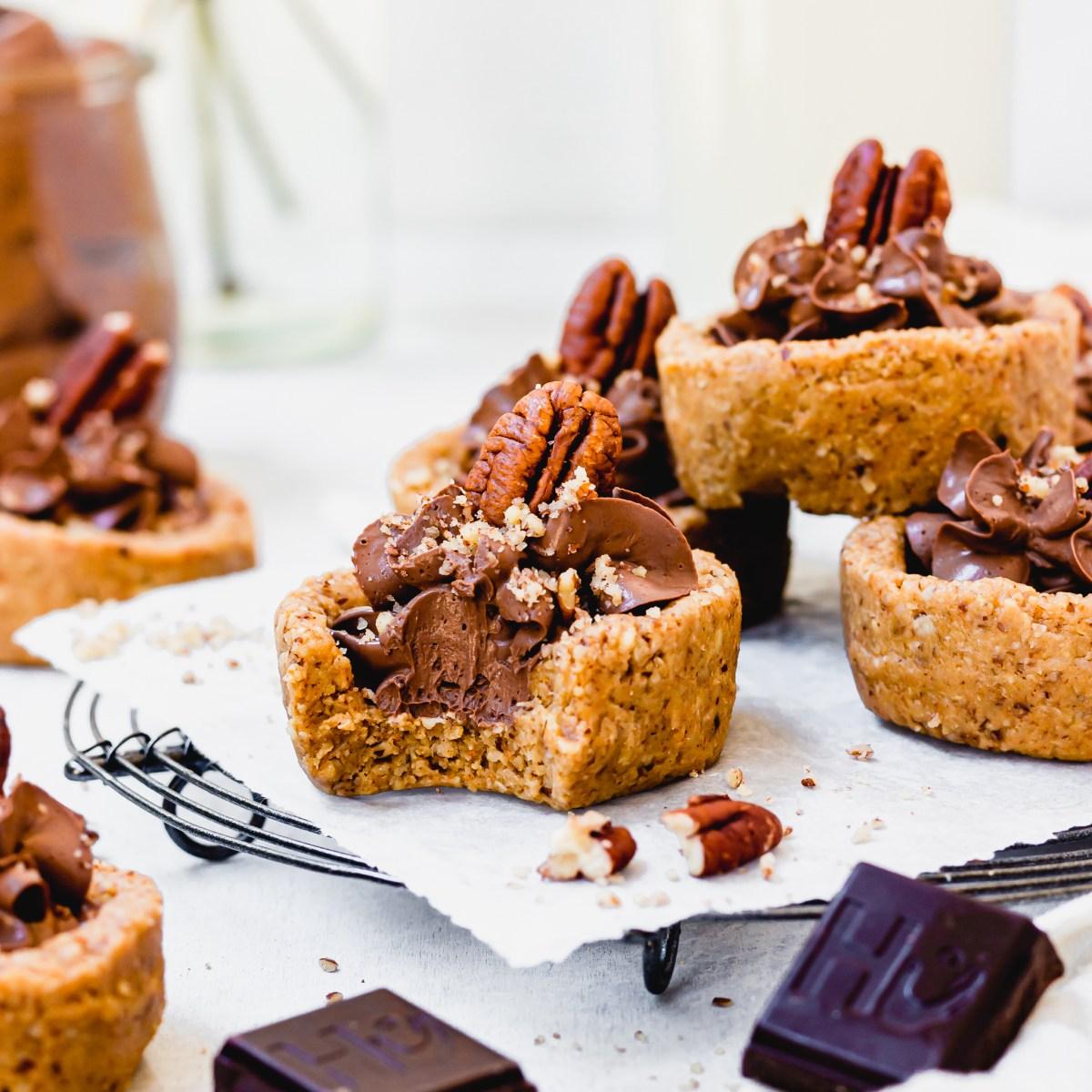 Square image of Mini Chocolate Mousse Pecan Tarts
