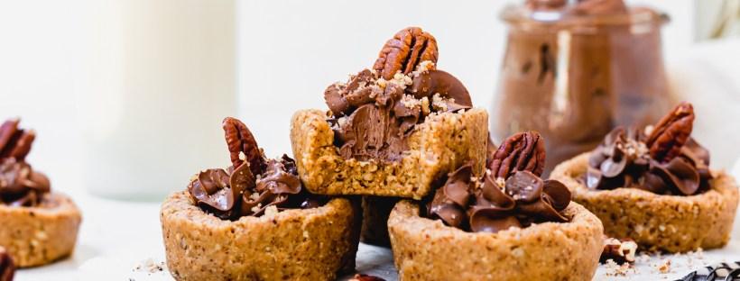 Landscape image of four Mini Chocolate Mousse Pecan Tarts