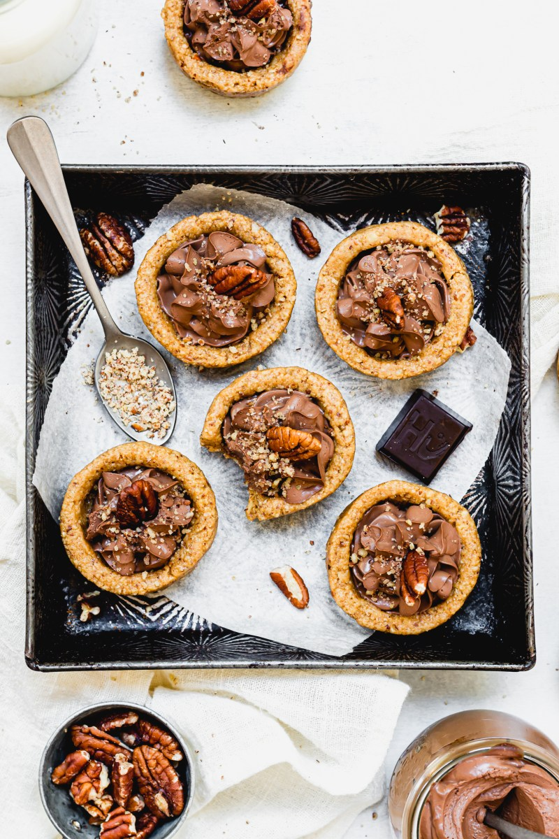 Mini Chocolate Mousse Pecan Tarts in a metal tray