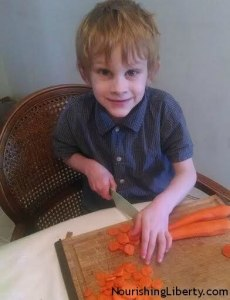 Chopping carrots for Chicken Soup