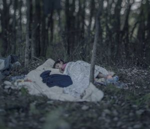 From a lost home in Baghdad to a refugee camp in Serbia, Lamar sleeps on the frozen forest ground.