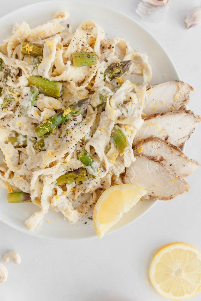 This Dairy Free Chicken Alfredo is creamy and delicious. With lemon, garlic, grilled chicken and asparagus - it's the perfect easy week night meal! A lighter version of an old classic, made dairy free with cashew and coconut cream.