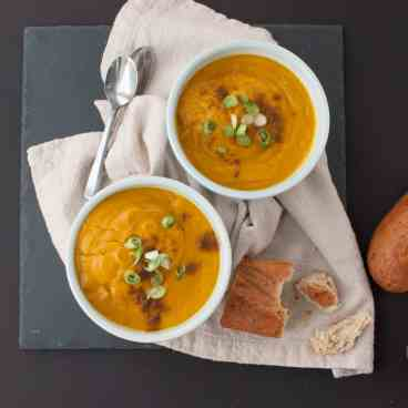 Curried Coconut & Pumpkin Soup | Do you have coconut milk, curry seasoning, and pumpkin puree at home? You're just 30 minutes away from a delicious & quick winter meal | www.nourishnutritionblog.com