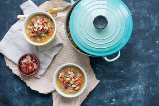 bacon and bean soup in bowls with crock pot