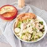 #ad Greek Salad with Roasted Red Pepper Hummus Dressing | www.nourishnutritionblog.com