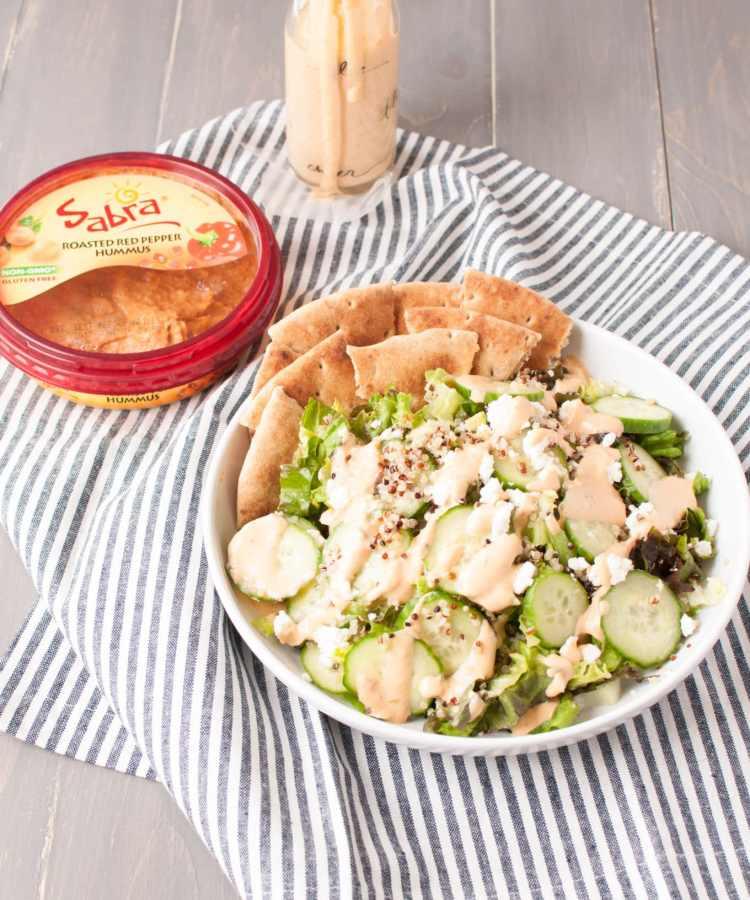 #ad Greek Salad with Roasted Red Pepper Hummus Dressing   www.nourishnutritionblog.com