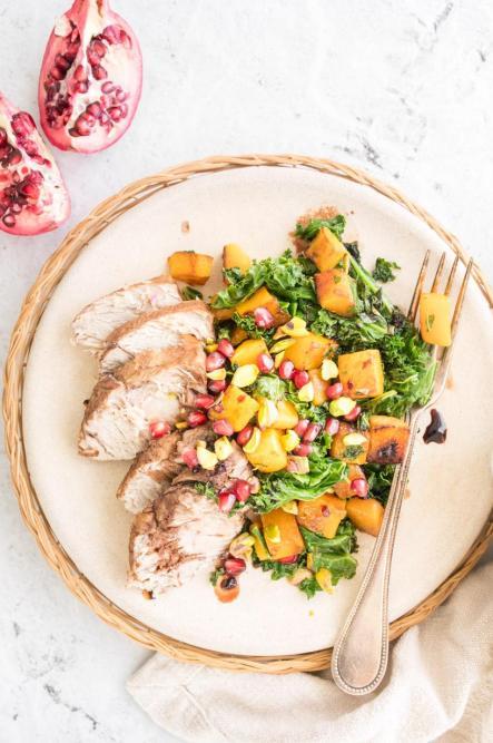 Plated Warm Kale Salad with Pomegranate Balsamic Marinated Pork Loin
