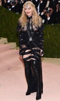 """EDS NOTE NUDITY - Madonna arrives at The Metropolitan Museum of Art Costume Institute Benefit Gala, celebrating the opening of """"Manus x Machina: Fashion in an Age of Technology"""" on Monday, May 2, 2016, in New York. (Photo by Evan Agostini/Invision/AP)"""
