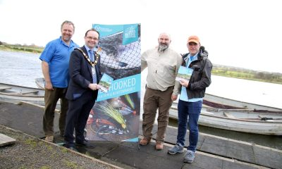The Mayor of Antrim & Newtownabbey, Councillor Paul Hamill launches the new Angling Guide at Straid Fishery with Ray McKeeman (Straid Fishery Manager), Harry McAteer (Secretary of Straid Fly Fishers) and Stevie Munn (Professional Fishing Guide).