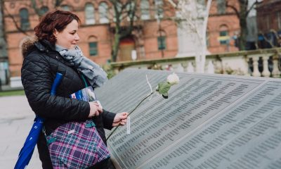 Bangor woman, Alison Kerrigan, lays a rose in memory of her great, great uncle after the Titanic Memorial Service in the grounds of Belfast City Hall. The annual event is held in memory of all those who died after RMS Titanic sank on her maiden voyage in 1912.