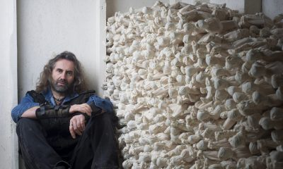 Rob and stack of figures from his Shrouds of the Somme Exhibition