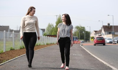 Infrastructure Minister Nichola Mallon viewing the continuing work on the Strathfoyle Greenway development during a visit to Derry.