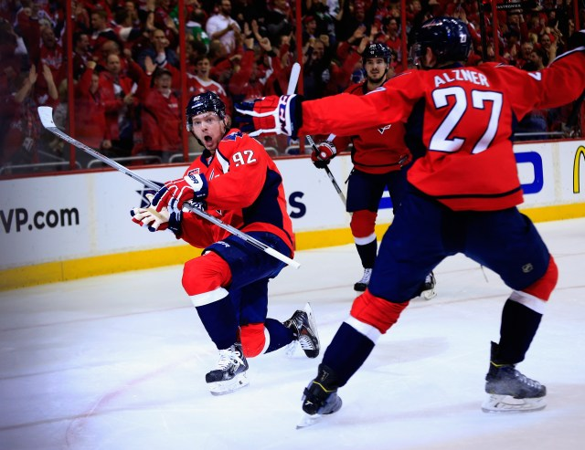 WASHINGTON, DC - APRIL 23:  Evgeny Kuznetsov #92 of the Washington Capitals celebrates after scoring a first period goal against the New York Islanders in Game Five of the Eastern Conference Quarterfinals during the 2015 NHL Stanley Cup Playoffs at Verizon Center on April 23, 2015 in Washington, DC.  (Photo by Rob Carr/Getty Images)