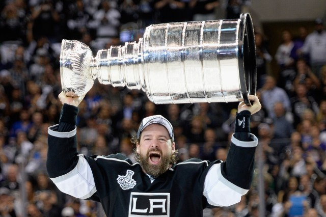 LOS ANGELES, CA - JUNE 13:  Justin Williams #14 of the Los Angeles Kings celebrates with the Stanley Cup after the Kings 3-2 double overtime victory against the New York Rangers in Game Five of the 2014 Stanley Cup Final at Staples Center on June 13, 2014 in Los Angeles, California.  (Photo by Harry How/Getty Images)