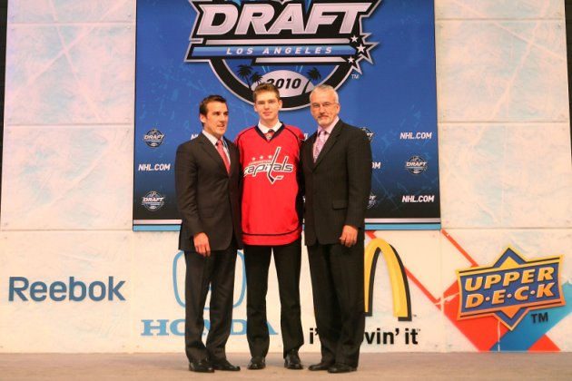 LOS ANGELES, CA - JUNE 25:  Evgeny Kuznetsov, drafted 26th overall by the Washington Capitals, poses on stage with team personnel during the 2010 NHL Entry Draft at Staples Center on June 25, 2010 in Los Angeles, California.  (Photo by Bruce Bennett/Getty Images)