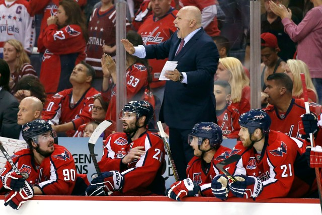 Washington Capitals head coach Barry Trotz, center, stands on the bench to call a timeout during the third period of Game 6 in the second round of the NHL Stanley Cup hockey playoffs against the New York Rangers, Sunday, May 10, 2015, in Washington. The Rangers won 4-3. (AP Photo/Alex Brandon)