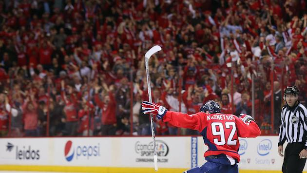 WASHINGTON, DC - APRIL 27: Evgeny Kuznetsov #92 of the Washington Capitals celebrates his game winning goal at 12:42 of the third period against the New York Islanders in Game Seven of the Eastern Conference Quarterfinals during the 2015 NHL Stanley Cup Playoffs at Verizon Center on April 27, 2015 in Washington, DC. The Capitals defeated the Islanders 2-1 to win the series 4 games to 3. (Photo by Bruce Bennett/Getty Images)