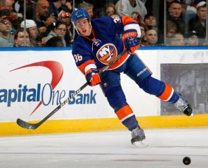 UNIONDALE, NY - MARCH 24: Travis Hamonic #36 of the New York Islanders passes the puck during an NHL hockey game against the Atlanta Thrashers at the Nassau Coliseum on March 24, 2011 in Uniondale, New York. (Photo by Paul Bereswill/Getty Images)