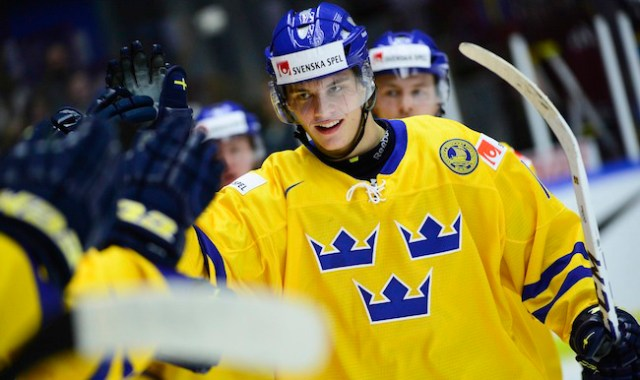 Sweden's Andre Burakowsky celebrates scoring his team's fifth goal during the IIHF World Junior Championship preliminary round group B icehockey match between Norway and Sweden at Malmo Arena in Malmo, Sweden, on Sunday Dec. 29, 2013. (AP Photo/TT/Ludvig Thunman) SWEDEN OUT