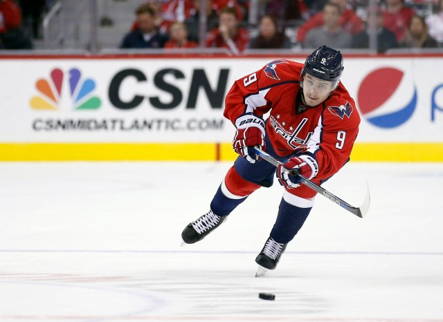 Washington Capitals defenseman Dmitry Orlov (9), from Russia, passes the puck in the third period of an NHL hockey game against the Colorado Avalanche, Saturday, Nov. 21, 2015, in Washington. The Capitals won 7-3. (AP Photo/Alex Brandon)
