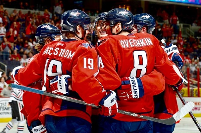 WASHINGTON, DC - APRIL 11: Nicklas Backstrom #19 of the Washington Capitals celebrates with his teammates after scoring a goal in the second period during an NHL game against the Chicago Blackhawks at Verizon Center on April 11, 2014 in Washington, DC. (Photo by Patrick McDermott/NHLI via Getty Images)