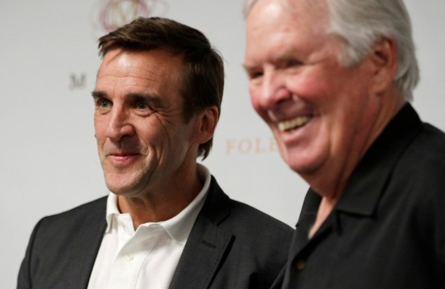 George McPhee, left, and NHL's expansion Las Vegas franchise owner Bill Foley attend a news conference Wednesday, July 13, 2016, in Las Vegas. The Las Vegas NHL expansion team named McPhee as its first general manager. (AP Photo/John Locher)
