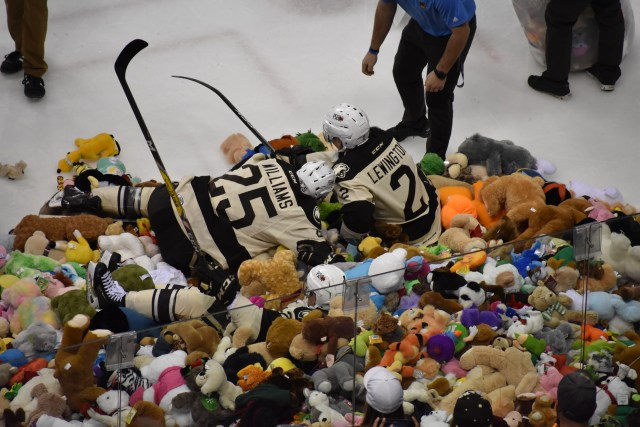These bears weren't tossed - Lewington, Williams, and Monardo dive into the pile - photo Julie Beidler