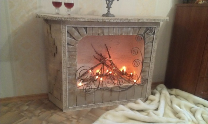 Fireplace from cardboard with her rocks