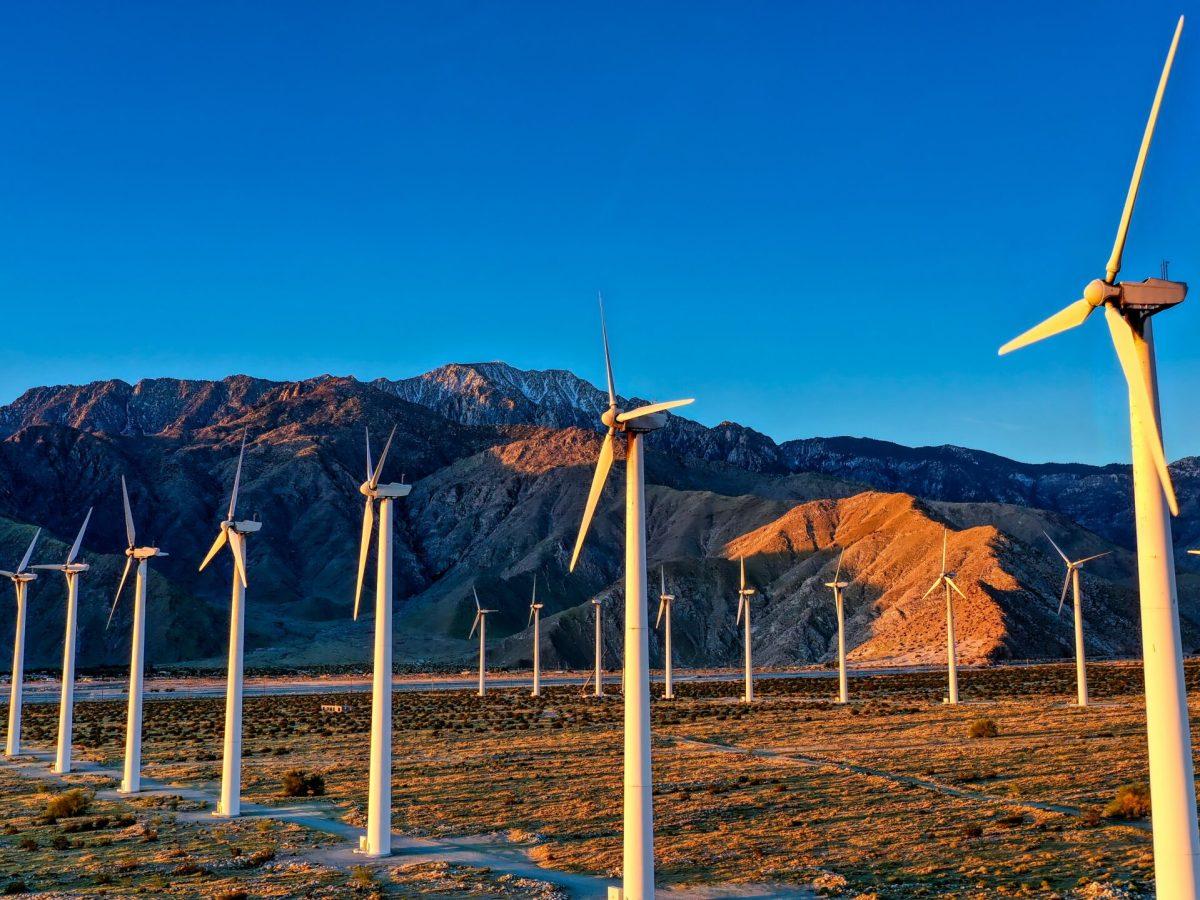 Windmills and mountains. Photo by Cameron Venti via Unsplash