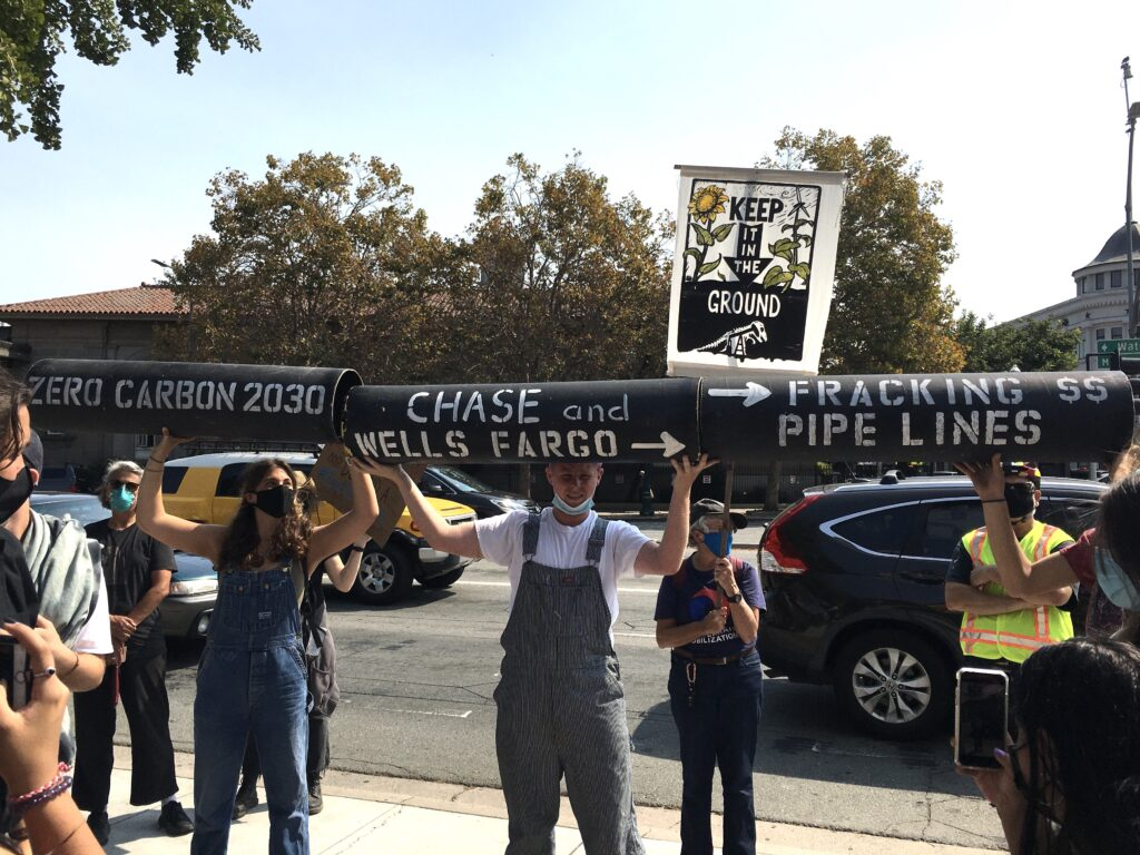 Youth for Climate Justice action 9-24: Students with pipelines at Clock Tower - photo by Lynda Marín