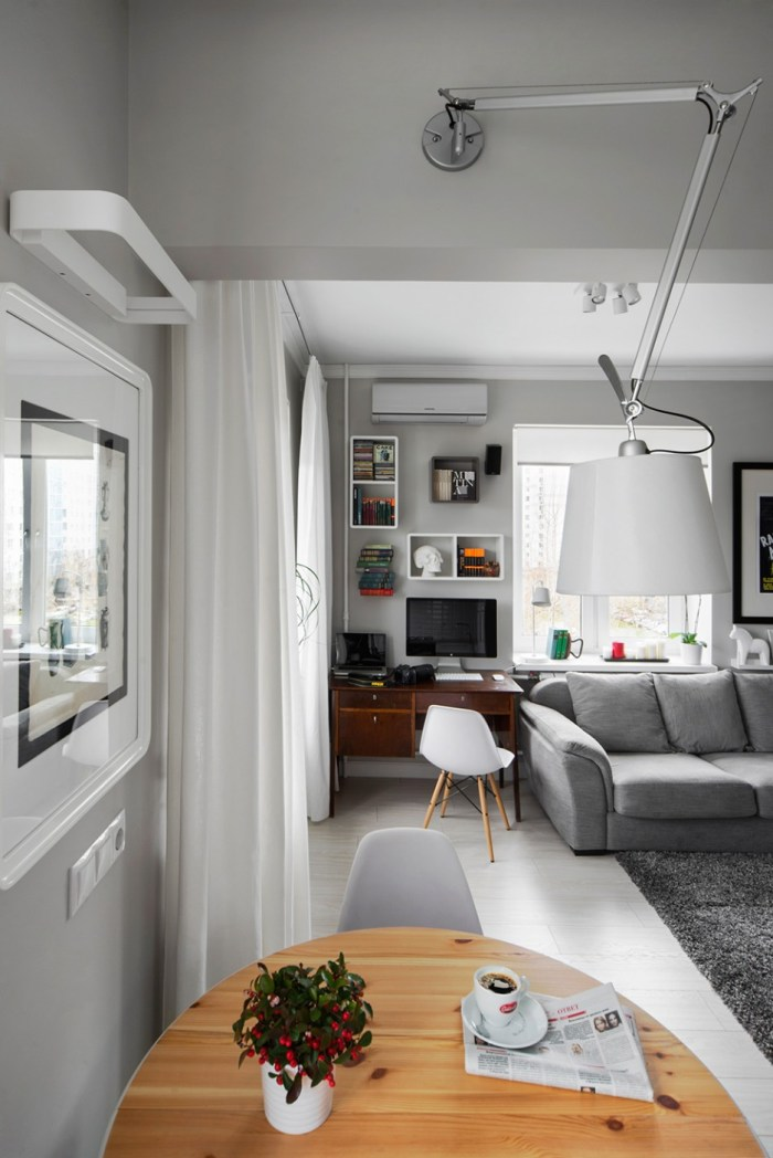 Simple-Combination-of-Wooden-Circular-Dining-Table-and-Coffee-Placed-on-It-Plus-White-Ceramic-Flower-Vase-and-Pendant-Lamp-936x1402