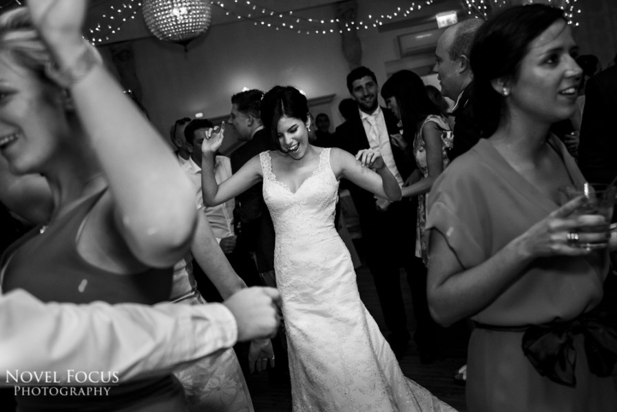 bride dancing at reception at manor by the lake