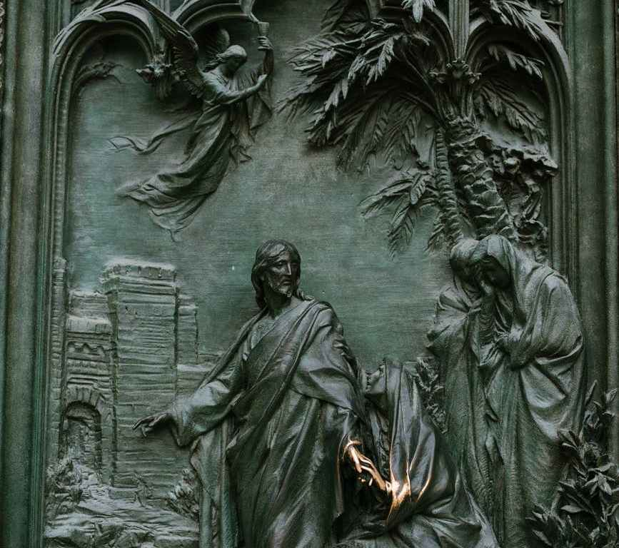 amazing details of carved bronze gate of ancient cathedral