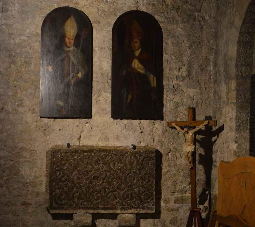 icons and crucifix in old stone church