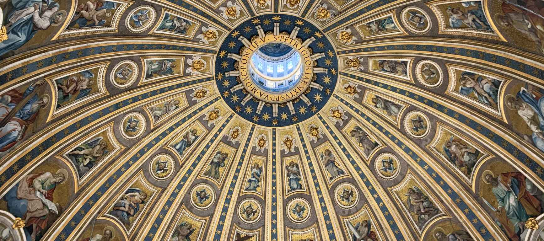 majestic dome ceiling with fresco paintings in catholic cathedral