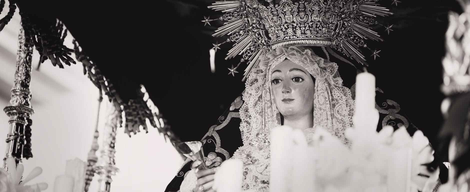 grayscale photo of religious statue