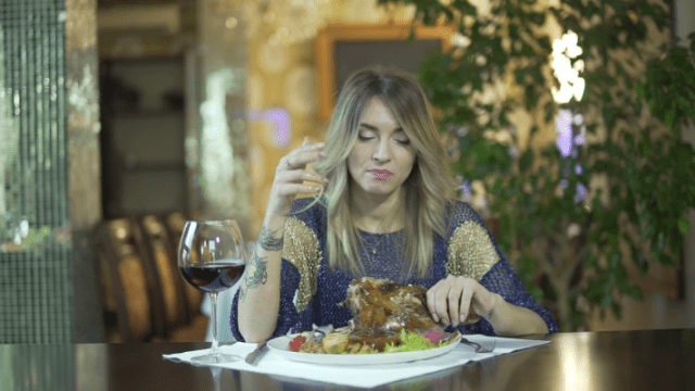videoblocks-young-attractive-tattooed-blond-girl-in-fancy-dinner-restaurant-licking-greasy-fingers-inappropriate-behaviour-in-public-ruod5a9cz-thumbnail-full01