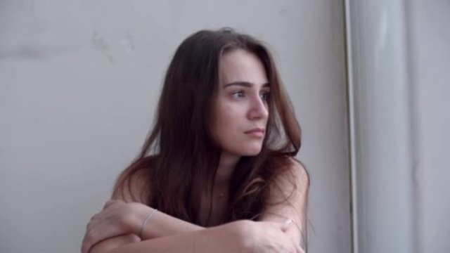 depositphotos-237705480-stock-video-young-sad-depressed-woman-sitting