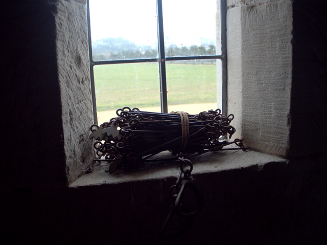 Chains on a window sill in the stables