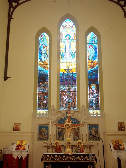 The altar and stained glass windows at Holy Trinity, North Hobart