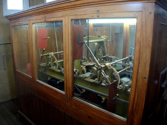The clock mechanism, safely housed in its own case