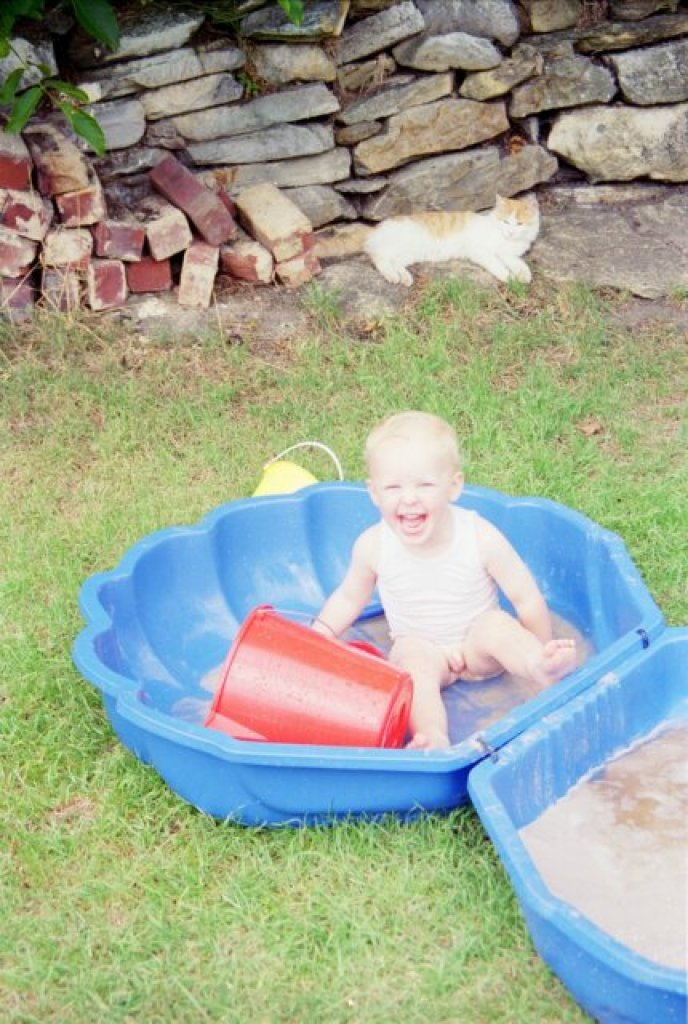 Alex with new sandpit at Seymour Street, Christmas Eve 1994