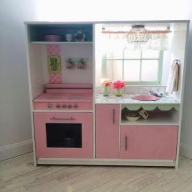 Diy play kitchen made from old entertainment center #