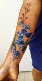 forearm tattoos tattoo vine arm flowers watercolor realistic colorful feather birth roses
