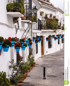 terraced white houses andalucia spain decorated traditional style colourful flower pots mijas one villages 40472357