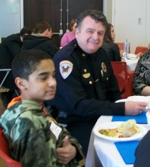 Chief Carmody sits with his mentee, Justice.