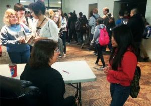Student Maria Pablo shares a moment with author Sonia Nazario during her visit to Wyoming